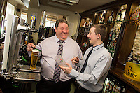 Michael Perry, lessee of The Fountain Bridge shows the way to pour a perfect pint to barman Ben Lovegrove