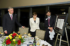 September 29, 2011; Professor James McAdams unveils a gift for Dr. Horst Koehler, former President of the Federal Republic of Germany and wife, Eva Luise Koehler after dinner in the 14th floor penthouse of the Hesburgh Library. Photo by Barbara Johnston/University of Notre Dame