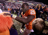 CHARLOTTESVILLE, VA- NOVEMBER 12: Running back Kevin Parks #25 of the Virginia Cavaliers greets fans after the game against the Duke Blue Devils on November 12, 2011 at Scott Stadium in Charlottesville, Virginia. Virginia defeated Duke 31-21. (Photo by Andrew Shurtleff/Getty Images) *** Local Caption *** Kevin Parks
