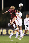 03 December 2010: Boston College's Julia Bouchelle (12) and Stanford's Lindsay Taylor (right). The Stanford University Cardinal defeated the Boston College Eagles 2-0 at WakeMed Stadium in Cary, North Carolina in an NCAA Women's College Cup semifinal game.