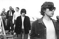"""Mick Jagger (front) and Bill Wyman (2nd R) from the British rock band """"The Rolling Stones"""" are arriving at the Airport Berlin Tegel in West Berlin, West Germany on 15.09.1965. 