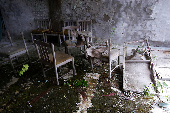 Room with chairs in the deserted Hotel Polisye (Polissia?) in Pripyat.<br /> Pripyat was built 1970 as a modern city for personnel at the Chernobyl Nuclear Power Plant a couple of kilometers south. After the nuclear disaster at reactor 4 on April 26 1986, the town's 48.000 inhabitants was evacuated to other parts of the country. Pripiat is today a radioactive ghost town. The whole area is contamined with nuclear material, the half-life of plutonium-239 is more than 24.000 years.<br /> Pripyat, Ukraine.<br /> August 2008.