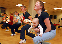 Six month old Johan doesn't seem to mind being used as a weight when his mother Elise Linberg attends her aerobics class..In contrast to most European countries, the Norwegian birth rate is a healthy 1.9. Norway's reputation as a child friendly society is partially founded on a succession of government initiatives to improve parents' rights and economic circumstances.