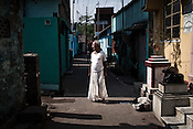 A priest from the Devanga community seen outside the local temple in the narrow lanes of Mahesh, Hooghly in West Bengal, India.  Photo: Sanjit Das/Panos for The Wall Street Journal. Slug: ICASTE