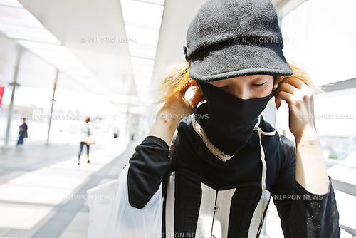 """In this photo made available on May 31, 2012 shows Mao Sugiyama putting on a protective mask in Kanagawa, near Tokyo, Japan, on May 29, 2012. Mao Sugiyama, 22, self-described as an asexual now just 2 months old, is a cartoonist, painter and illustrator living in Japan. Mao hated the idea of love and sex due to a series of past events relating to close people around him becoming victims of sexual crimes. In an effort to free himself from mankind, Mao underwent a surgical procedure in Tokyo to remove his male genitals and later serve them to paying guests at a small dinner event. He spent two years conducting extensive research about the removal of his genitals and had several sexual experiences with others prior to the surgery. The reasoning behind Mao's idea to host an event where he would cook his male parts and serve them to guests, was he needed to earn money to help cover the ongoing medical costs of the procedure. Five individuals consisting of men and women out of a small crowd who attended the dinner, ate Mao's specially cooked genitals. The men, however, were not able to completely finish eating the genitals as they grew disgusted whereas the women were able to finish everything on their plates entirely. The women commented on Mao's parts as """"delicious."""" With Mao being an artist that he is, his vision is to create beautiful art without the realization of being a man or woman and excluding love and sex out of his system completely. (Photo by Christopher Jue/Nippon News)"""