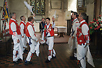 East Kent Morris Men dancing inside the church of St Peter and St Paul Charing Kent UK. Spring Bank Holiday Monday. 2013