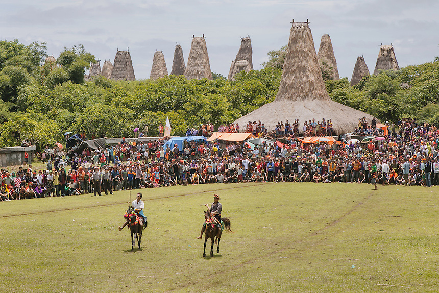 Witnessed by a massive crowd, two Pasola warriors ready to charge the enemy forces during the event in Wainyapu, Kodi. Pasola is an ancient tradition from the Indonesian island of Sumba. Categorized as both extreme traditional sport and ritual, Pasola is an annual mock horse warfare performed in response to the harvesting season. In the battelfield, the Pasola warriors use blunt spears as their weapon. However, fatal accident still do occurs.