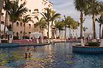 Couples enjoying the swimming pool at Pueblo Bonito Rose' Resort, Cabo San Lucas, Baja California, Mexico