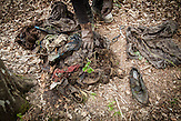 A deminer from NPA showing clothings found during demining activities in the Srebrenica area.