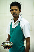 Arun Prakash, a masseuse at the National Research Institute of Panchakarma in Cheruthuruthy in Thissur district of Kerala, India.