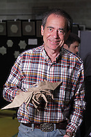 Origami designer and folder, Keith Nunas, Edmonton, Canada, with one of his flying insect designs.