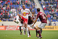 Thierry Henry (14) of the New York Red Bulls under pressure from Kosuke Kimura (27) and Brian Mullan (11) of the Colorado Rapids. The New York Red Bulls defeated the Colorado Rapids 4-1 during a Major League Soccer (MLS) match at Red Bull Arena in Harrison, NJ, on March 25, 2012.