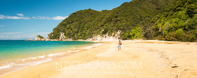 Young woman on Anatakapau Bay on Abel Tasman Coast Track, Abel Tasman National Park, Nelson Region, South Island, New Zealand