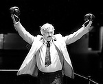 Miami's Howard Schnellenberger gives a victory stance after he squared off in the boxing ring with Florida State coach Bobby Bowden to promote the FSU- Miami game November 7 ,1983.   Miami defeated FSU 17-16. (Mark Wallheiser/TallahasseeStock.com)