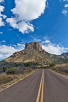 Another capture in a vertical format view with a longer road looking up at Casa Grande in Big Bend National Park in the Chiso mountains in far west Texas.