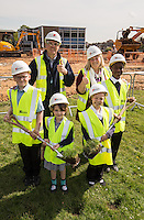 Site manager Ken Appleby of Kier with Chris Frith (right) of the Education Advisory Body with Wainwright Primary Academy School Council pupils at the ground-breaking ceremony to mark the start of works on their new school. Turning the first sod from left are Conor Willetts, 10, Leah Gregory, 7, Chloe Musgrove, 7 and Peace Olaoti, 11.