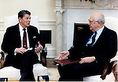 United States President Ronald Reagan meets Ambassador Anatoly Fyodorovich Dobrynin of the Soviet Union in the Oval Office of the White House in Washington, D.C. on Tuesday, April 8, 1986.  .Mandatory Credit: Bill Fitz-Patrick - White House via CNP