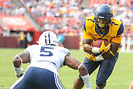 Landover, MD - September 24, 2016: West Virginia Mountaineers running back Rushel Shell (7) tries to run over BYU Cougars defensive back Dayan Lake (5) during game between BYU and WVA at  FedEx Field in Landover, MD.  (Photo by Elliott Brown/Media Images International)