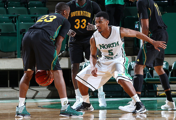 DENTON, TX - DECEMBER 16:  Chris Jones #5 of the North Texas Mean Green guards Todd Nelson #23 of the Southeastern Louisiana Lions at the UNT Coliseum on December 16, 2012 in Denton, Texas. (Photo by Rick Yeatts/Getty Images)