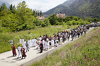 Switzerland. Canton Valais. St-Maurice. Africa Saints Pilgrimage (P&egrave;lerinage aux Saints d'Afrique). Religious <br /> procession. The people, dressed in white, are originally from Eritrea. They walk in front of the procession and carry the cross. The procession goes from V&eacute;roliez  a quarter of St-Maurice to St-Maurice's abbey.  2.06.13 &copy; 2013 Didier Ruef