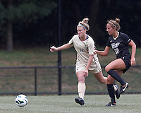 Boston College midfielder Jana Jeffrey (12) and University of Central Florida midfielder Madison Barney (22) chase down an errant pass. After two overtime periods, Boston College tied University of Central Florida, 2-2, at Newton Campus Field, September 9, 2012.