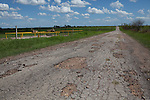 Schlinke Road in Dewitt County, Texas bears significant damage left by heavy trucks from nearby oilfield operations. July 25, 2012. Lance Rosenfield / Prime
