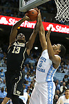 20 January 2016: North Carolina's Kennedy Meeks (3) blocks a shot by Wake Forest's Bryant Crawford (13). The University of North Carolina Tar Heels hosted the Wake Forest University Demon Deacons at the Dean E. Smith Center in Chapel Hill, North Carolina in a 2015-16 NCAA Division I Men's Basketball game. UNC won the game 83-68.