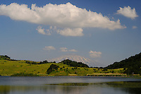 A landscape of a lake in Nebrodi Park, Sicily, Italy mountains, with Mount Etna in the background.