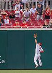 25 August 2016: Washington Nationals outfielder Trea Turner pulls in a fly ball against the Baltimore Orioles at Nationals Park in Washington, DC. The Nationals blanked the Orioles 4-0 to salvage one game of their 4-game home and away series. Mandatory Credit: Ed Wolfstein Photo *** RAW (NEF) Image File Available ***