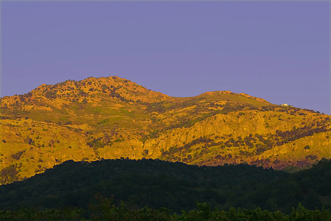 Sun sets on eastern hills of Napa Valley, in Stags Leap region