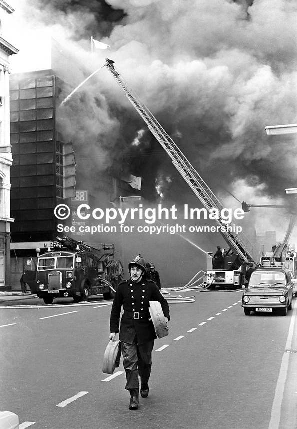 Firemen fight blaze at Belfast Co-op's main store in York Street, following the explosion of a Provisional IRA bomb. Several people were slightly injured. At the time it was stated that &pound;8M worth of damage was caused and that around 1000 jobs were endangered. NI Troubles. Ref: 19720510002 <br /> <br /> Copyright Image from Victor Patterson, 54 Dorchester Park, Belfast, UK, BT9 6RJ<br /> <br /> t: +44 28 90661296<br /> m: +44 7802 353836<br /> vm: +44 20 88167153<br /> e1: victorpatterson@me.com<br /> e2: victorpatterson@gmail.com<br /> <br /> For my Terms and Conditions of Use go to www.victorpatterson.com