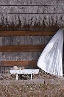The cabins at CasasNaAreia have been constructed using traditional methods, with untreated straw held in place by irregular planks of wood and topped with a thatched roof