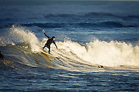 Late afternoon cutback - By this stage most of the break was in shadow from the sun going behind the large hills just behind the beach. But there was a small gap between the hills where the sun was still getting though, &amp; this was the only part it was shining on.