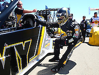 Jul 30, 2016; Sonoma, CA, USA; NHRA top fuel driver Tony Schumacher stretches prior to climbing into his dragster during qualifying for the Sonoma Nationals at Sonoma Raceway. Mandatory Credit: Mark J. Rebilas-USA TODAY Sports