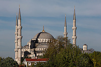General view of Sultan Ahmed Mosque, or Blue Mosque, 1609-16, by Mehmet Aga,  Istanbul, Turkey. The Sultan Ahmed Mosque, commissioned by Sultan Ahmed I, dominates the Istanbul skyline with its cascading domes and six minarets. Built near the Hagia Sophia, it combines Byzantine style with Islamic architecture. The historical areas of the city were declared a UNESCO World Heritage Site in 1985. Picture by Manuel Cohen.