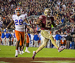 Florida State quarterback Deondre Francois reacts to scoring a touchdown in front of Florida linebacker Kylan Johnson in the second half of an NCAA college football game in Tallahassee, Fla., Saturday, Nov. 26, 2016. Florida State defeated Florida 33-13. (AP Photo/Mark Wallheiser)