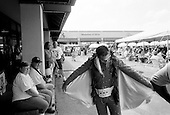 Memphis, Tennessee<br /> USA<br /> August 14, 2002<br /> <br /> An Elvis Presley impersonators set to perform at an outdoor tent stage set-up near Graceland for the 25th anniversary of his death.