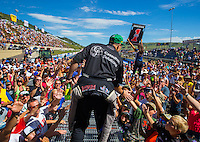 Jul 26, 2015; Morrison, CO, USA; NHRA top fuel driver Larry Dixon greets fans prior to the Mile High Nationals at Bandimere Speedway. Mandatory Credit: Mark J. Rebilas-USA TODAY Sports