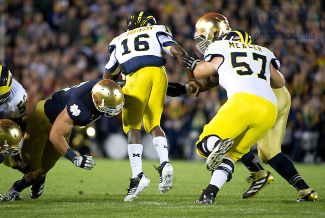 Sept. 22, 2012; Notre Dame linebacker Manti Te'o tackles Michigan quarterback Denard Robinson during the second quarter.  Photo by Barbara Johnston/University of Notre Dame