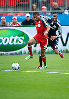 22 October 2011: New England Revolution defender Darrius Barnes #25 and Toronto FC forward Ryan Johnson #9 in action during a game between the New England Revolution and Toronto FC at BMO Field in Toronto..The game ended in a 2-2 draw.