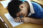 A boy practices writing a letter of the Vietnamese alphabet at a center for children who have been affected by dioxin exposure in the village of Hoa Nhon, near Da Nang, Vietnam. The Da Nang Association of Victims of Agent Orange/Dioxin says that more than 1,400 children around the city suffer from mental and physical disabilities because of dioxin exposure, a legacy of the U.S. military's use of Agent Orange and other herbicides during the Vietnam War more than 40 years ago. About 60 children attend the Hoa Nhon center each day, where they are taught to read and write, sew clothes, make handicrafts and help their families raise crops and livestock. Many of them have mental disabilities, while others cannot hear or speak. The Vietnam Red Cross estimates that 3 million Vietnamese suffer from illnesses related to dioxin exposure, including at least 150,000 people born with severe birth defects since the end of the war. The U.S. government is paying to clean up dioxin-contaminated soil at the Da Nang airport, which served as a major U.S. base during the conflict. But the U.S. government still denies that dioxin is to blame for widespread health problems in Vietnam and has never provided any money specifically to help the country's Agent Orange victims. May 29, 2012.
