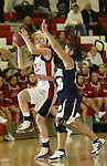 SOUTHBURY, CT, 01/02/08- 010208BZ05- Pomperaug's Kasey Dean (33) looks for the shot under pressure from Notre Dame's Christine Rivera (15) during their game at Pomperaug High School in Southbury Wednesday night.<br /> Jamison C. Bazinet Republican-American