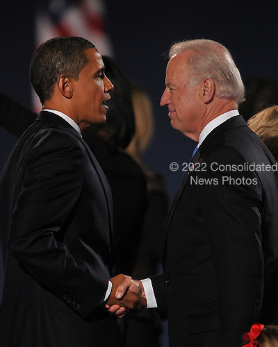 Chicago, IL - November 4, 2008 -- United States President-elect Barak Obama and Vice President-elect Joseph Biden shake hands Obama finished speaking in Lower Hutchinson Field, Grant Park, Chicago, Illinois after his election as President of the United States on Tuesday, November 4, 2008..Credit: Ron Sachs / CNP.(Restriction: No New York Metro or other Newspapers within a 75 mile radius of New York City)