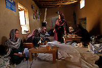 Members of a women Co-op knit dresses at a Mosque in the Yakawlang  District of Bamyan province. <br /> <br /> Afghanistan - 2011