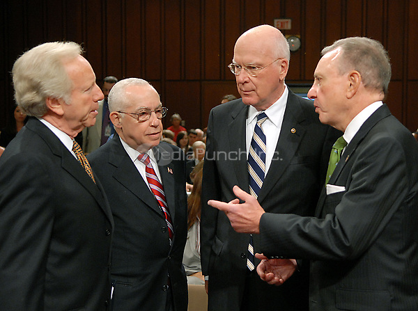 Washington, DC - October 17, 2007 -- United States Senators Joseph Lieberman (Independent of Connecticut); Judge Michael B. Mukasey; Patrick Leahy (Democrat of Vermont); and Arlen Specter (Republican of Pennsylvania) share some thoughts before the United States Senate Judiciary Committee confirmation hearing on the nomination of Judge Mukasey to be Attorney General of the United States in Washington, D.C. on Wednesday, October 17, 2007.<br /> Credit: Ron Sachs/CNP/MediaPunch