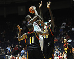 "Ole Miss' Terrance Henry (1) vs. Grambling State's Peter Roberson (4) and Bryant Purvis (11) during the first half at the C.M. ""Tad"" Smith Coliseum in Oxford, Miss. on Monday, November 14, 2011.."