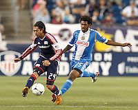 New England Revolution midfielder Lee Nguyen (24) passes the ball as Philadelphia Union defender Sheanon Williams (25) closes. In a Major League Soccer (MLS) match, the New England Revolution tied Philadelphia Union, 0-0, at Gillette Stadium on September 1, 2012.