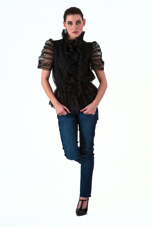 Beautiful brunette fashion model, walking, on white background