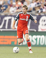 Toronto FC midfielder Terry Dunfield (23) brings the ball forward. In a Major League Soccer (MLS) match, Toronto FC defeated New England Revolution, 1-0, at Gillette Stadium on July 14, 2012.