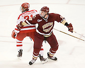 Sean Escobedo (BU - 21), Jimmy Hayes (BC - 10) - The visiting Boston College Eagles defeated the Boston University Terriers 3-2 to sweep their Hockey East series on Friday, January 21, 2011, at Agganis Arena in Boston, Massachusetts.